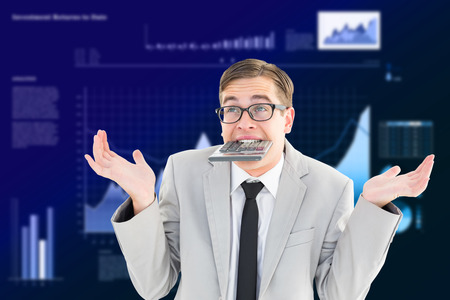 geeky: Geeky shrugging businessman biting calculator against business interface with graphs and data