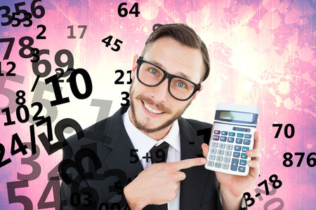 cheesy grin: Geeky businessman pointing to calculator  against purple vignette