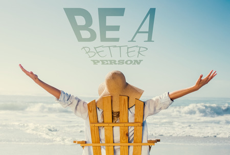 Woman relaxing in deck chair by the sea against be a better person photo