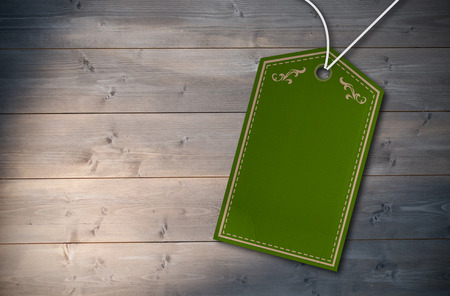 bleached: Elegant green and gold tag against bleached wooden planks background Stock Photo
