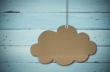 Hanging cloud tag against painted blue wooden planks Imagens - 37985412