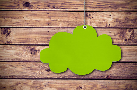 cloud tag: Hanging cloud tag against wooden planks background