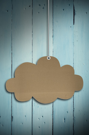 cloud tag: Hanging cloud tag against painted blue wooden planks