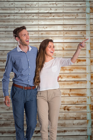 fade away: Full length of couple looking away against faded pine wooden planks Stock Photo