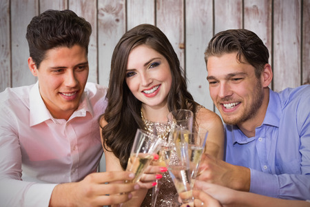 toasting: Friends toasting with champagne against wooden planks Stock Photo