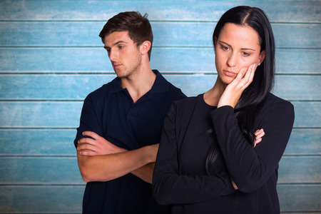 not talking: Couple not talking after argument against wooden planks