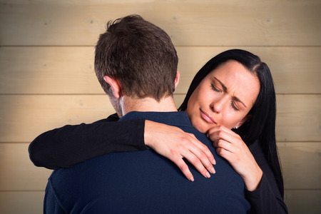 breaking up: Woman breaking up with boyfriend against bleached wooden planks background Stock Photo