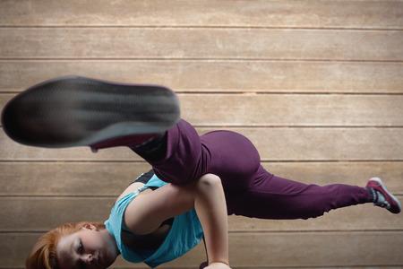 breakdancer: Pretty break dancer against wooden surface with planks Stock Photo