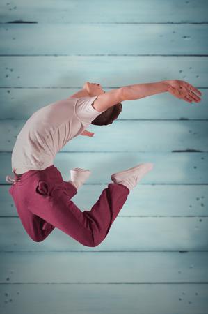 Cool break dancer against wooden planks photo