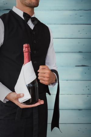 magnum: Waiter holding magnum of champagne against wooden planks