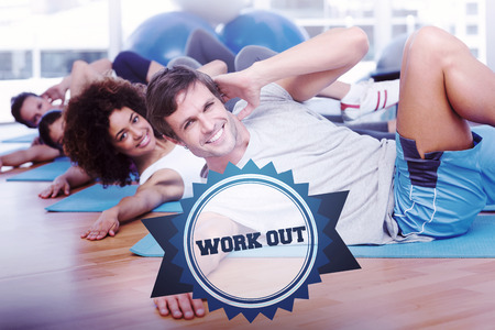 work out: The word work out and people doing pilate exercises in fitness studio against badge