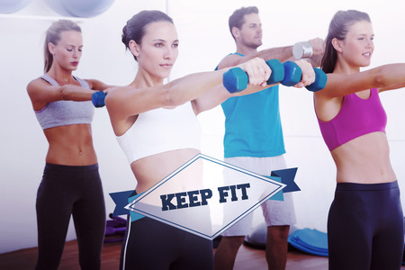 keep fit: The word keep fit and class exercising with dumbbells in gym against badge Stock Photo