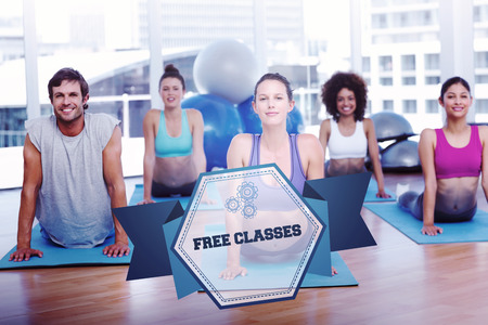 The word free classes and fit class doing the cobra pose in fitness studio against hexagon photo