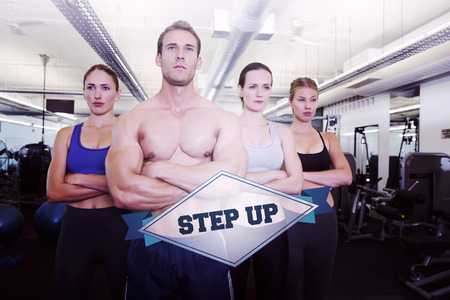 step up: The word step up and serious fitness class posing together against badge Stock Photo
