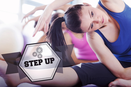 step up: The word step up and class and instructor doing stretching pilate exercises against hexagon Stock Photo