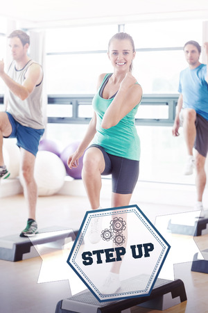 step up: The word step up and instructor with fitness class performing step aerobics exercise against hexagon