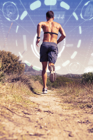 heart monitor: Shirtless man jogging with heart rate monitor around chest against fitness interface Stock Photo