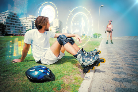 roller blade: Fit man getting ready to roller blade against fitness interface Stock Photo