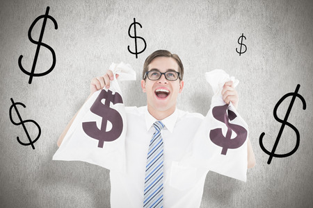 geeky: Geeky happy businessman holding bags of money against white background Stock Photo