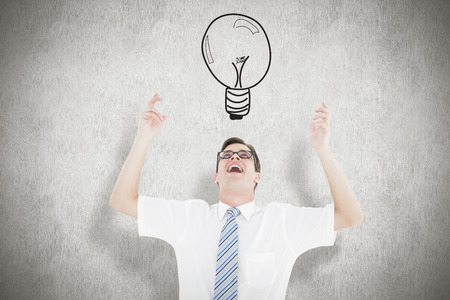 Geeky happy businessman with arms up against white background photo