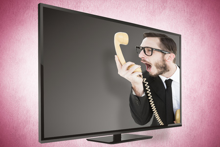 cheesy grin: Geeky businessman shouting at telephone against pink vignette