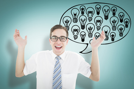 Geeky happy businessman with arms up against blue vignette background photo
