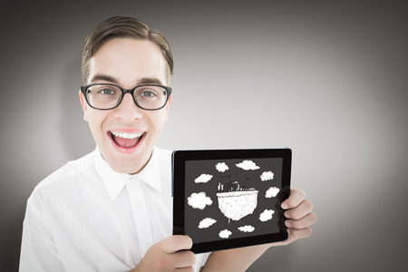 Geeky businessman showing his tablet pc against grey vignette photo