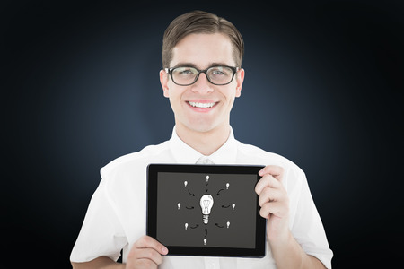 Geeky businessman showing his tablet pc against blue background with vignette photo