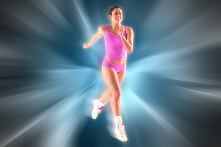 against abstract: Fit brunette running and jumping against abstract background Stock Photo
