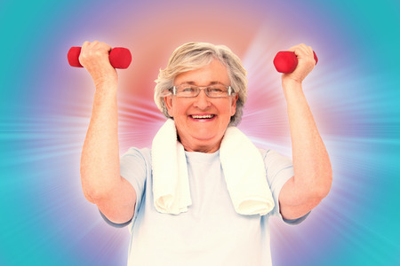 hand weights: Senior woman lifting hand weights against abstract background