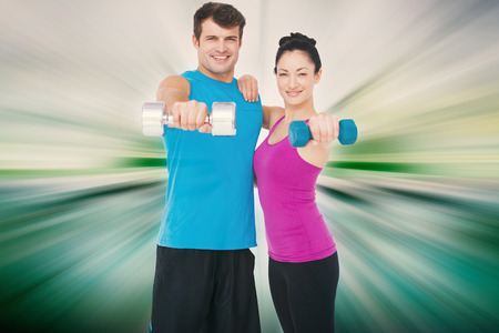 against abstract: Fit man and woman lifting dumbbells against abstract background Stock Photo