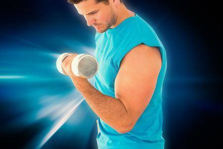 body concern: Sporty young man with dumbbell in gym against abstract background