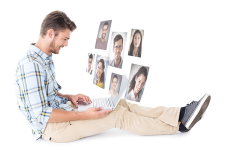 chinos: Handsome young man sitting using laptop against profile pictures