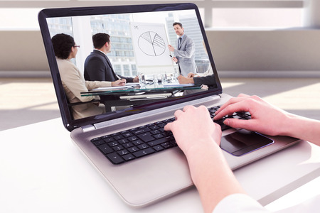 well dressed woman: Hands typing on laptop against business people in office at presentation