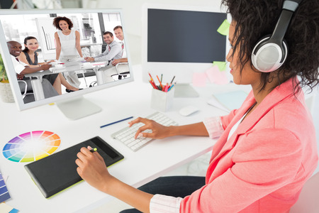 Female business woman giving a presentation  against casual female photo editor using computer photo