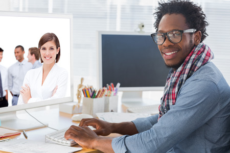 artists mannequin: Confident manager in front of her team with folded arms against portrait on a creative business worker on computer Stock Photo
