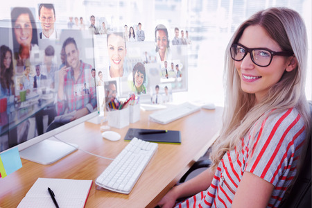 Attractive photo editor working on computer against handsome designer sit in his office photo