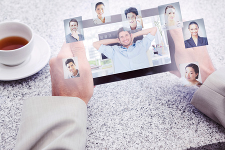 Cheerful creative business employee resting against profile pictures photo