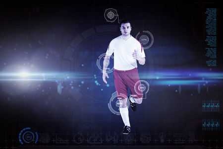 Football player in white jogging against blue dots on black background photo