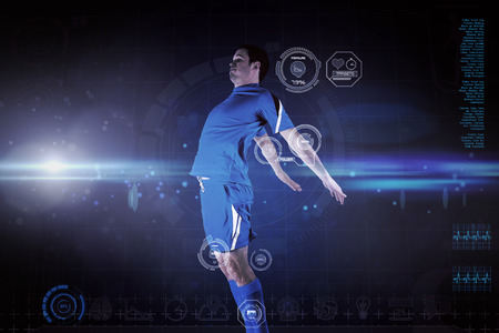 Football player in blue jumping against blue dots on black background photo
