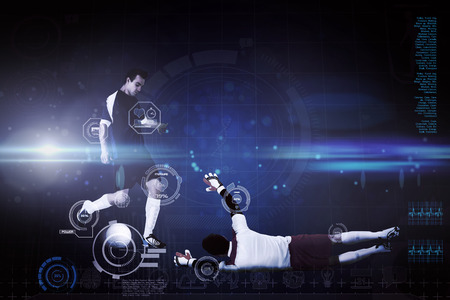 Football players tackling for the ball against blue dots on black background photo