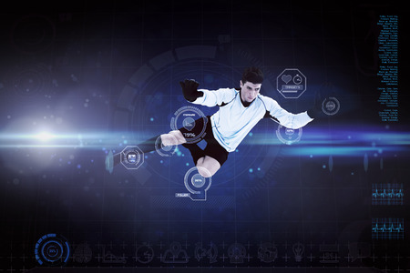 Football player against blue dots on black background photo