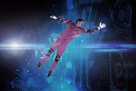 goal keeper: Fit goal keeper jumping up against futuristic black background