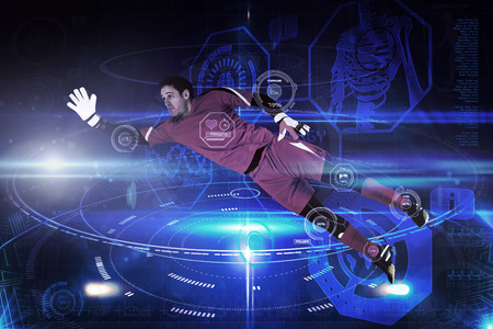 goal keeper: Fit goal keeper jumping up against futuristic black background with circles Stock Photo