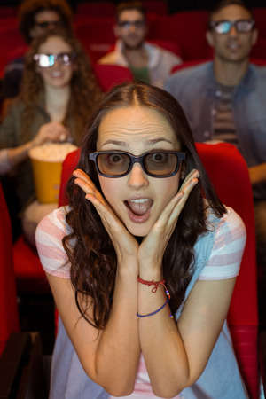 3d film: Young woman watching a 3d film at the cinema