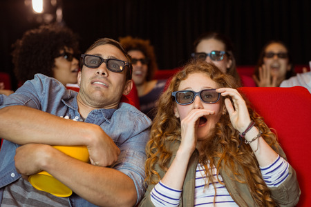 Young friends watching a 3d film at the cinema Stock Photo - 38101984