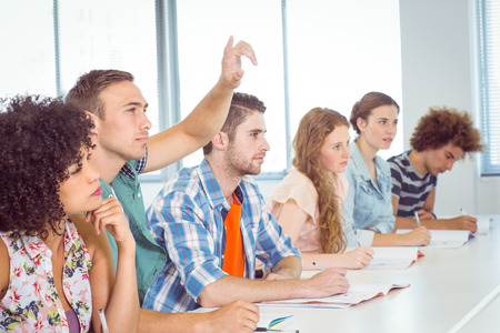 university classroom: Fashion students being attentive in class at the college