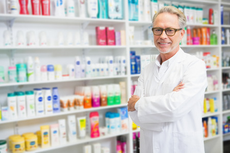 pharmacy: Handsome pharmacist smiling at camera at the hospital pharmacy Stock Photo
