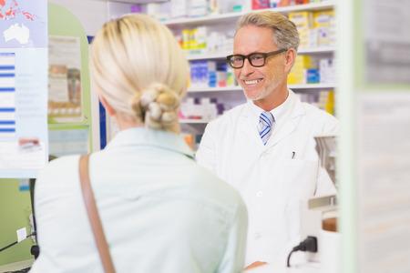 pharmacist: Senior pharmacist speaking with customer in the pharmacy Stock Photo