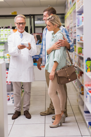 Pharmacist and customers talking about medication in the pharmacy
